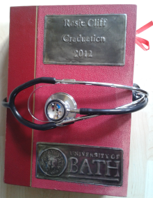 I used an old pictorial encyclopedia and created pewter plaques for the front. The clasp is made from an old stethoscope since her next step is medical school.