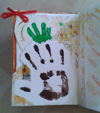 This page is on the theme of hand prints. The teenage hand print of my daughter forms a pocket. In the pocket is her baby hand print and some of her art work.