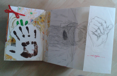 The page unfolds to reveal a sketch of a hand by my daughter and instructions to unfold again.