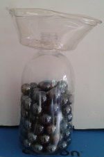 After melting a hole in the bottom of the deli container, I fitted it over a handsoap bottle and weighted it with florist's pebbles and voila - a vase!